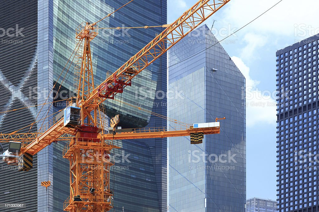 Skyscrapers and construction site in guangzhou stock photo