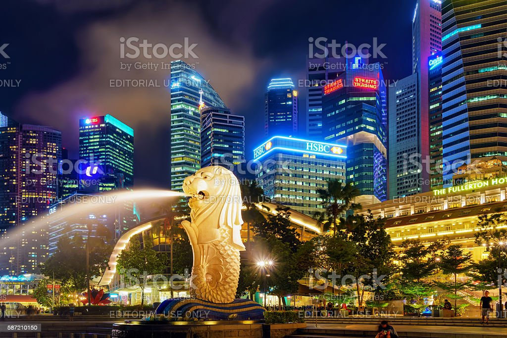 Skyscrapers and Merlion statue at Merlion Park at night stock photo
