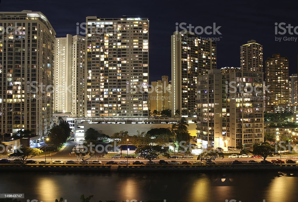 Skyscrapers and partial skyline of Honolulu, Hawaii, at night royalty-free stock photo