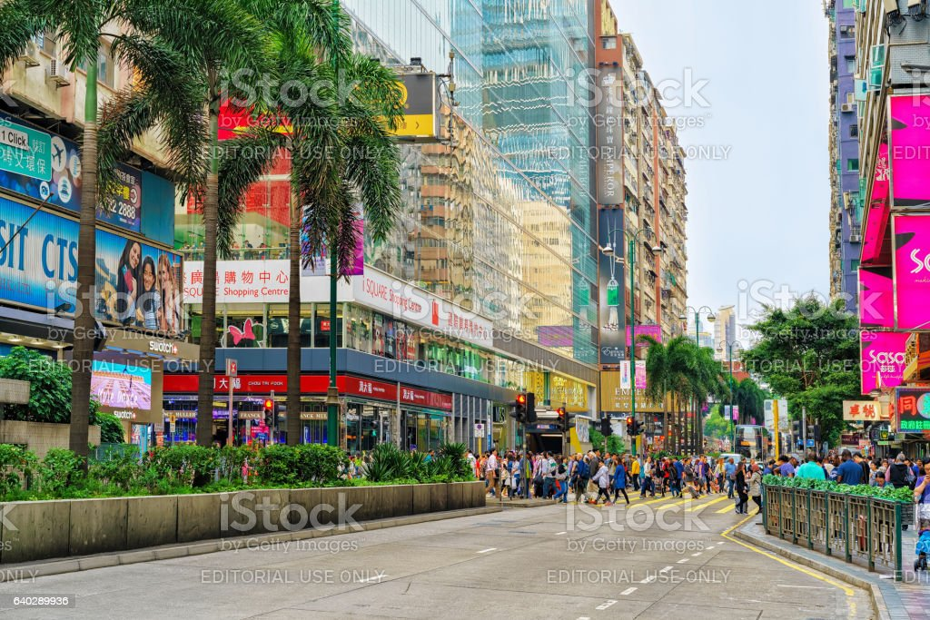 Skyscrapers and people in Nathan Road in Kowloon Hong Kong stock photo