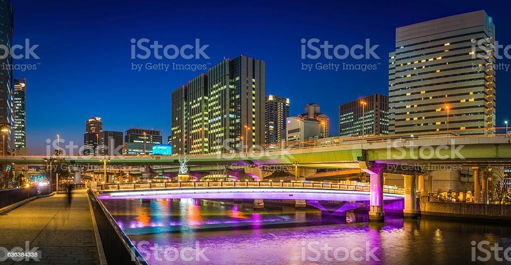 Skyscrapers highways neon night cityscape panorama illuminated dusk Osaka Japan stock photo