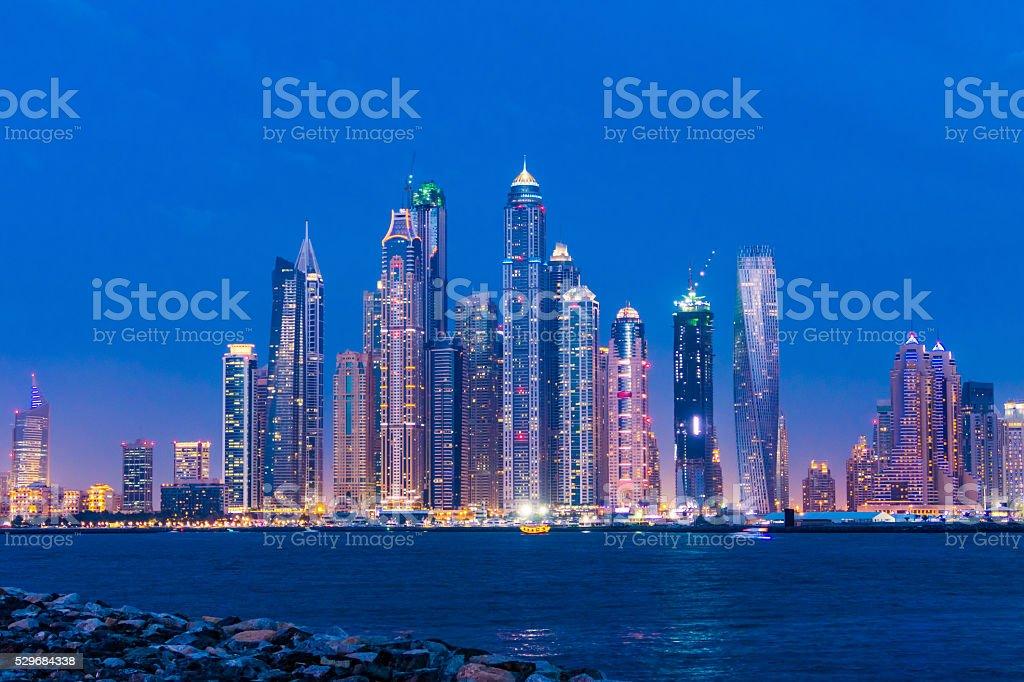 Skyscrapers in Dubai by night stock photo