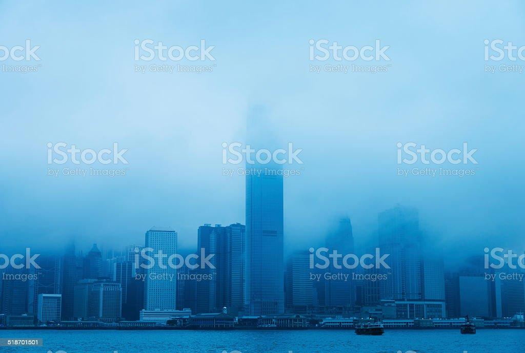 Skyscrapers in mist stock photo
