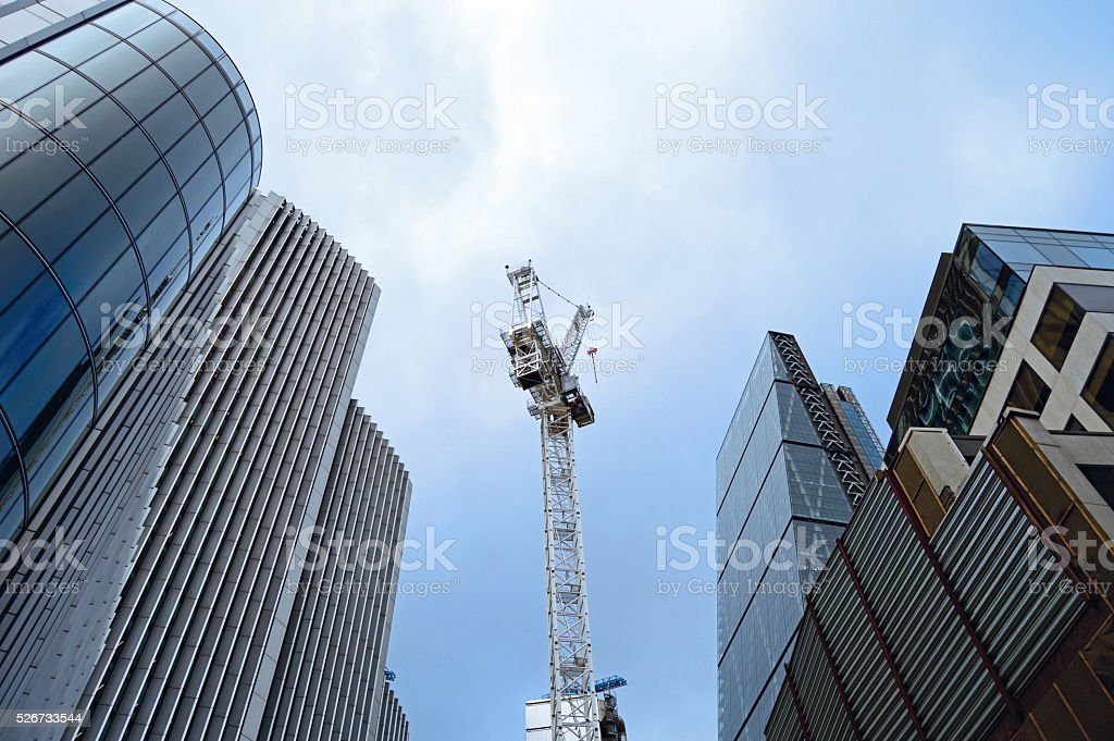Skyscrapers of London with construction crane in the middle stock photo