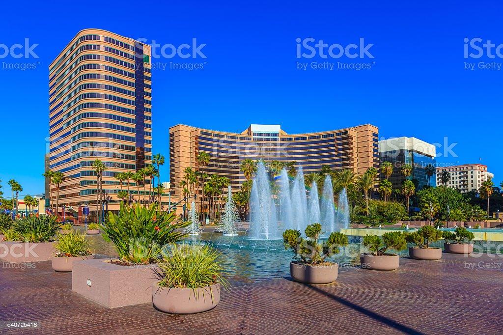 Skyscrapers of Long Beach skyline,fountain,plaza,night,CA stock photo