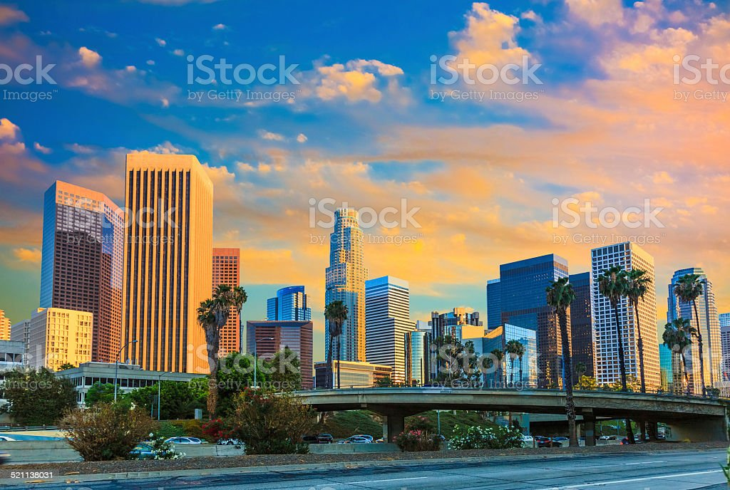 Skyscrapers of Los Angeles skyline with sunset clouds, CA stock photo