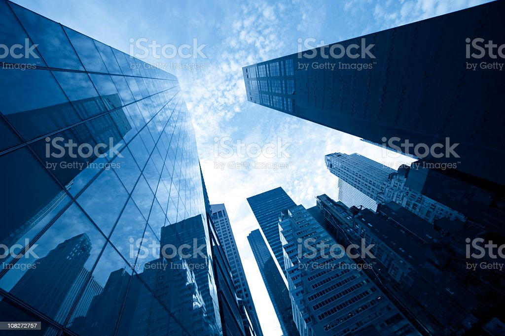 Skyscrapers of Manhattan with sky reflection in facade royalty-free stock photo