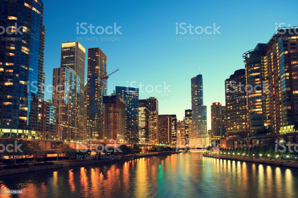 Skyscrapers on Chicago River at night stock photo