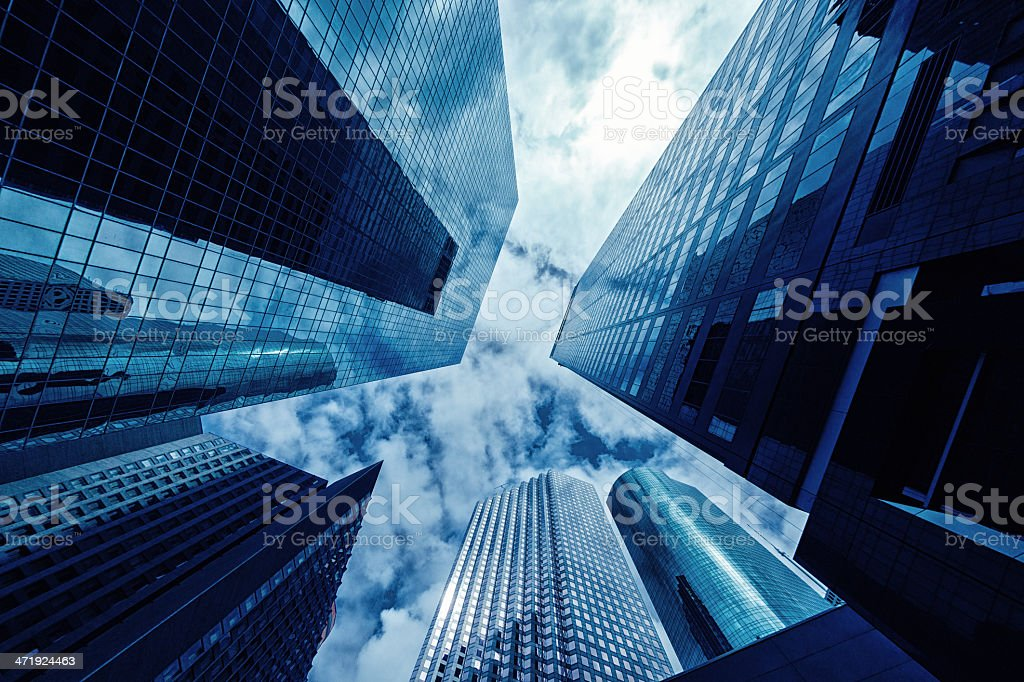 NYC skyscrapers photographed from the ground looking up stock photo