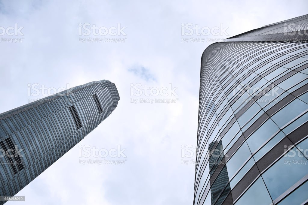 Skyscrapers with glass curtain walls and blue sky in Hong Kong, China stock photo