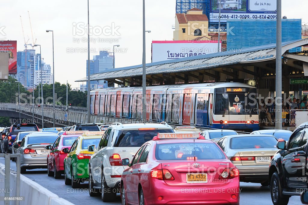 Skytrain and cars stuck in traffic jam stock photo