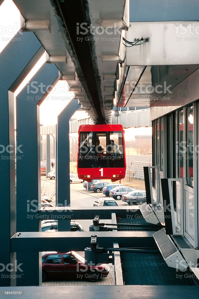 Sky-Train leaving station above paking lot royalty-free stock photo