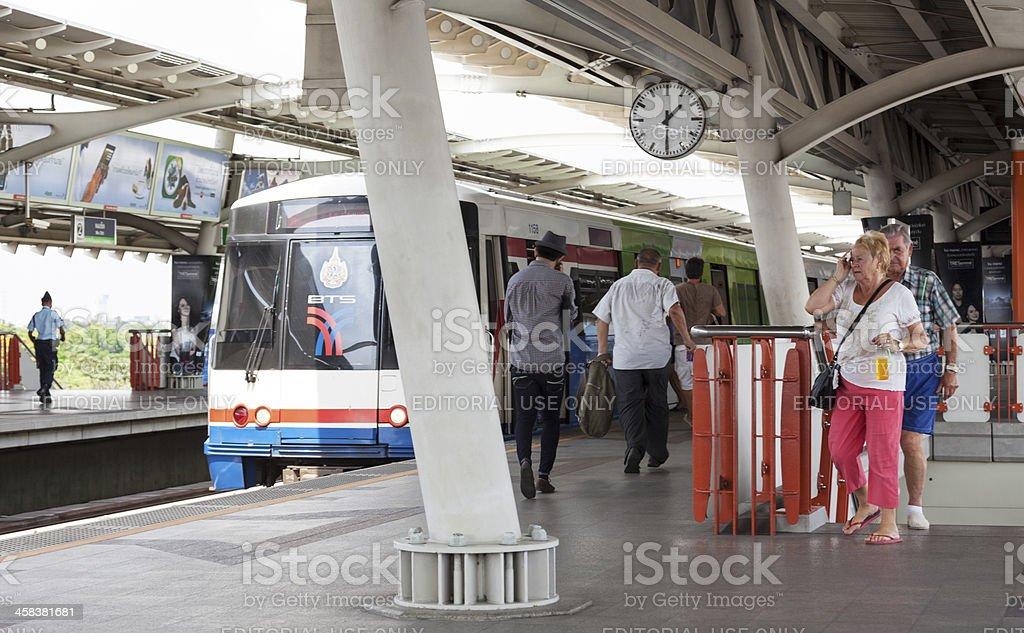 Skytrain station in Bangkok with sweaty tourists. royalty-free stock photo