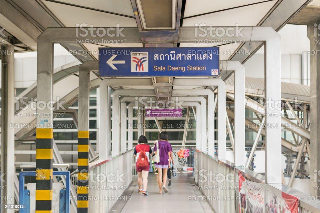 Skywalk at BTS skytrain train in Bangkok. Many people in Bangkok used skytrain to save time. stock photo