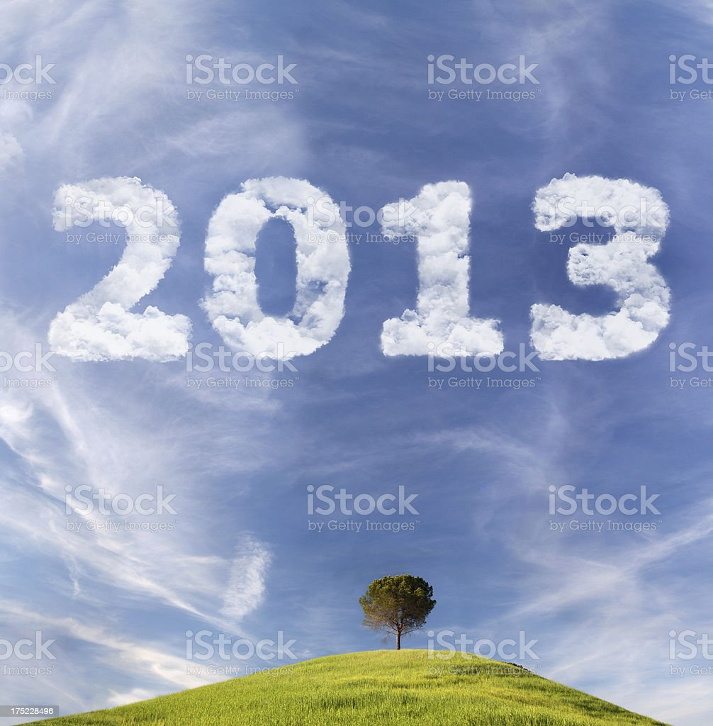 Skywriting with 2013 year on the Tuscany landscape view royalty-free stock photo