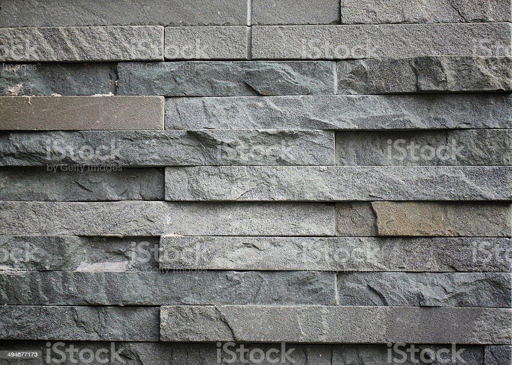 slab of dark stone arranged style in interior. stock photo