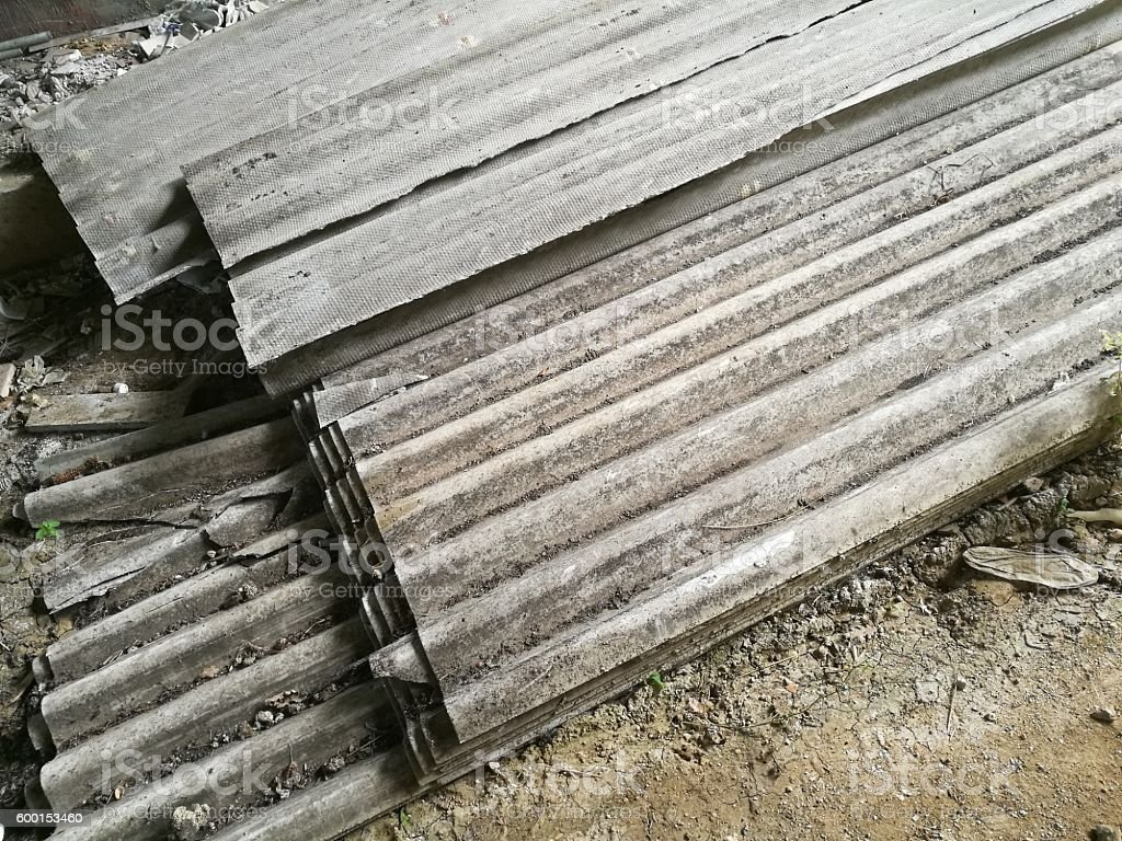 slabs of asbestos abandoned under overpass stock photo