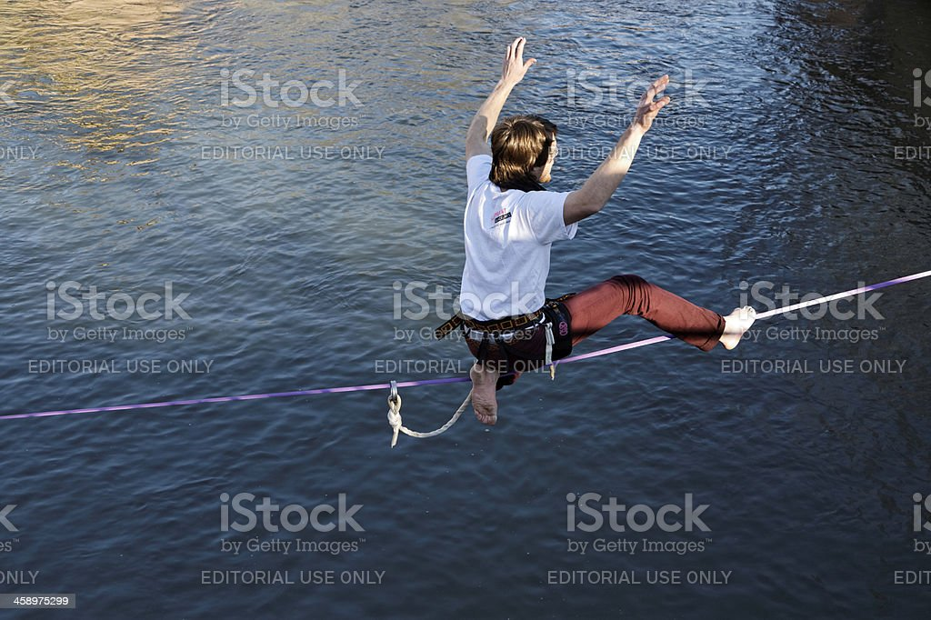 slackline - man walking the line stock photo