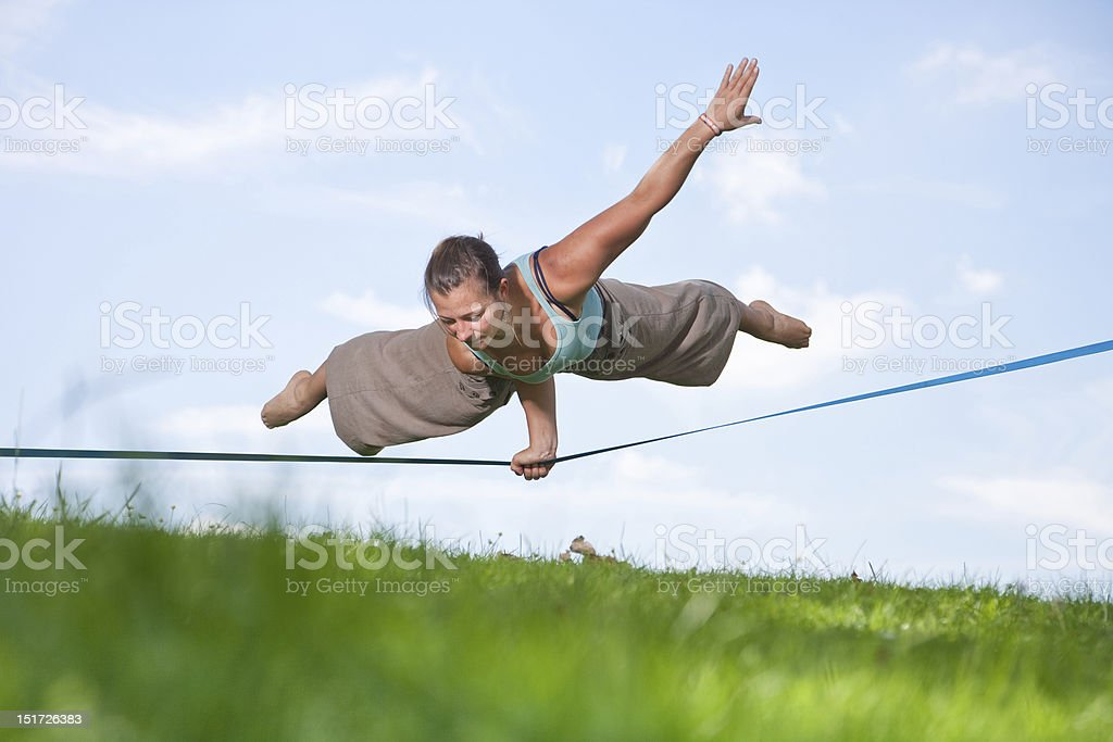 Slackline Series - Young Woman In The Park stock photo