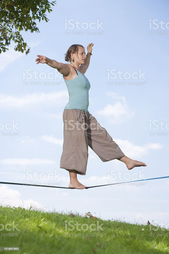 Slackline Series - Young Woman In The Park royalty-free stock photo