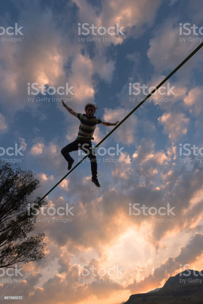 Slackliner silhouete floating in air stock photo