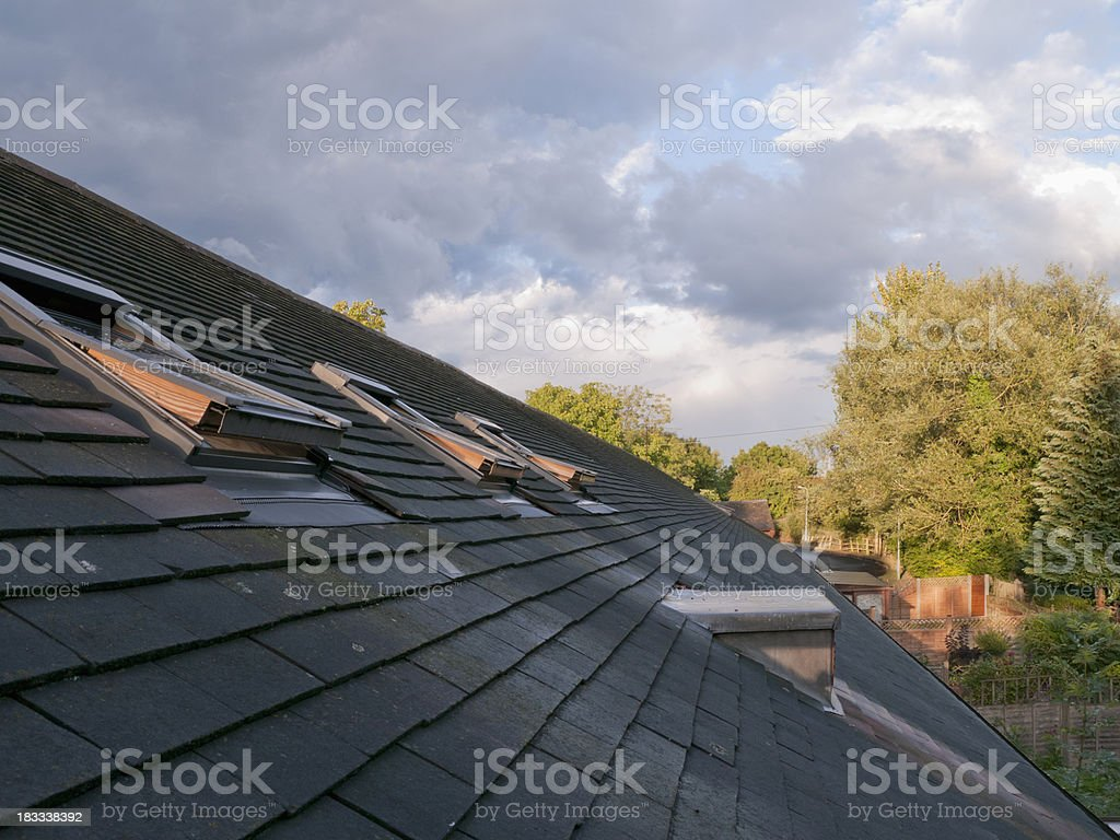 Slanted roof with attic windows stock photo