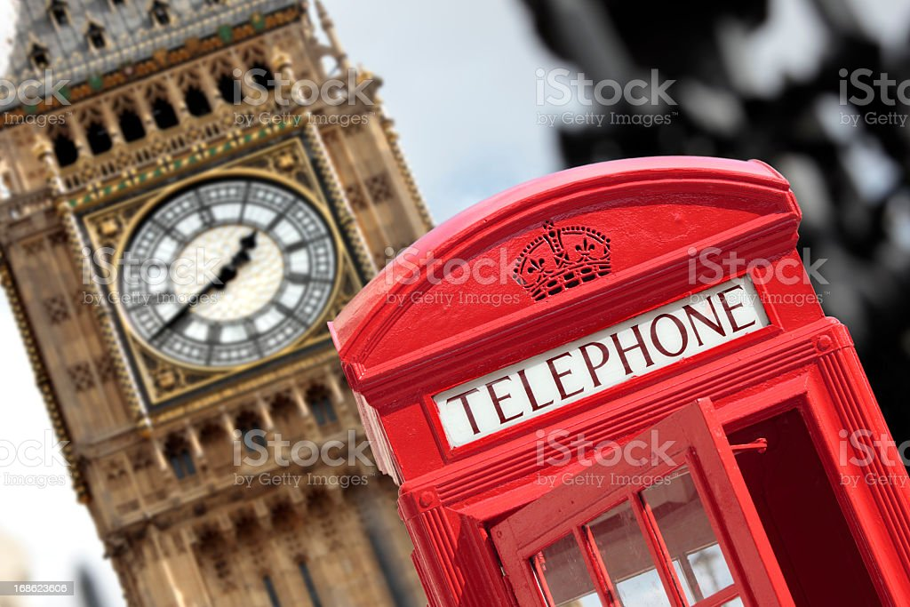 Slanted view of a red telephone booth in front of Big Ben royalty-free stock photo