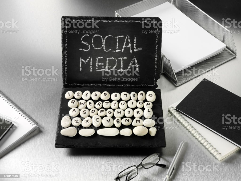 Slate and Pebble Computer with Modern Office Equipment stock photo