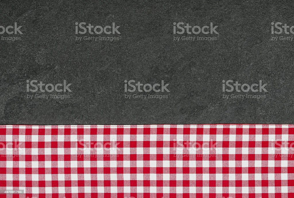 Slate plate with a red checkered tablecloth stock photo
