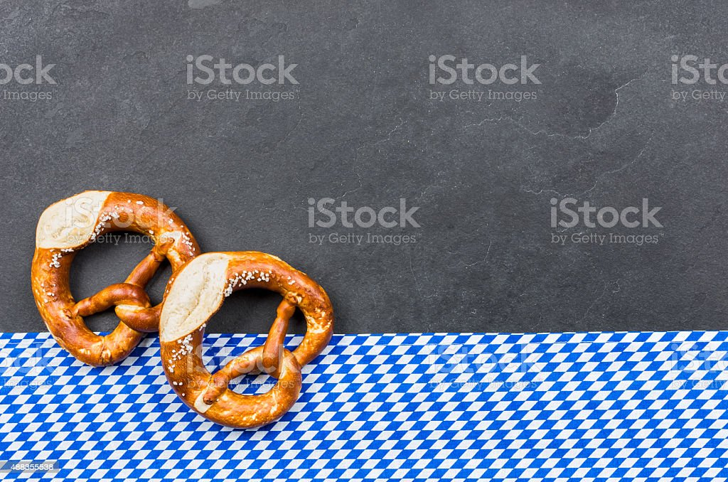Slate plate with two pretzels with a bavarian diamond pattern stock photo