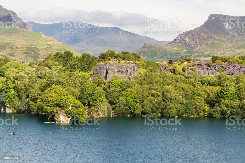 slate quarry lake with Snowdon stock photo