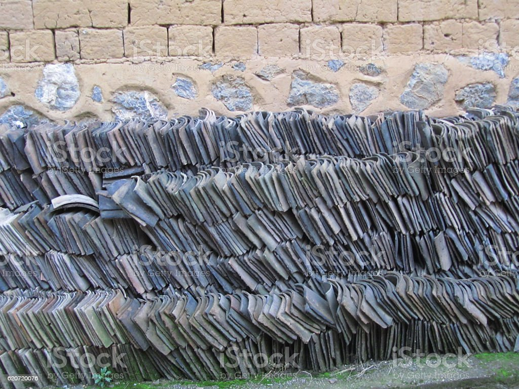 Slate Roof Tiles Stacked in Rows stock photo