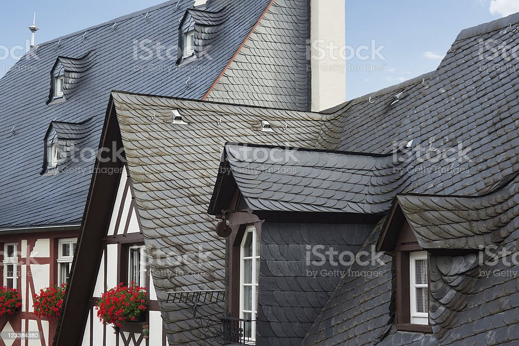 Slate roofs and timber frame facades stock photo