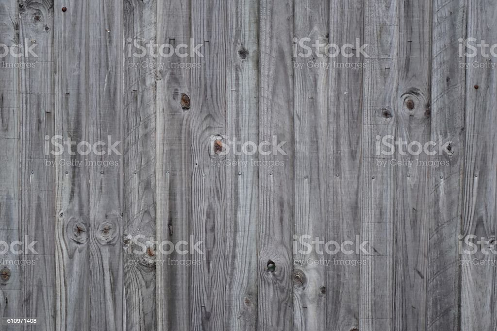 Slatted knitted wood fence grey for background, texture stock photo