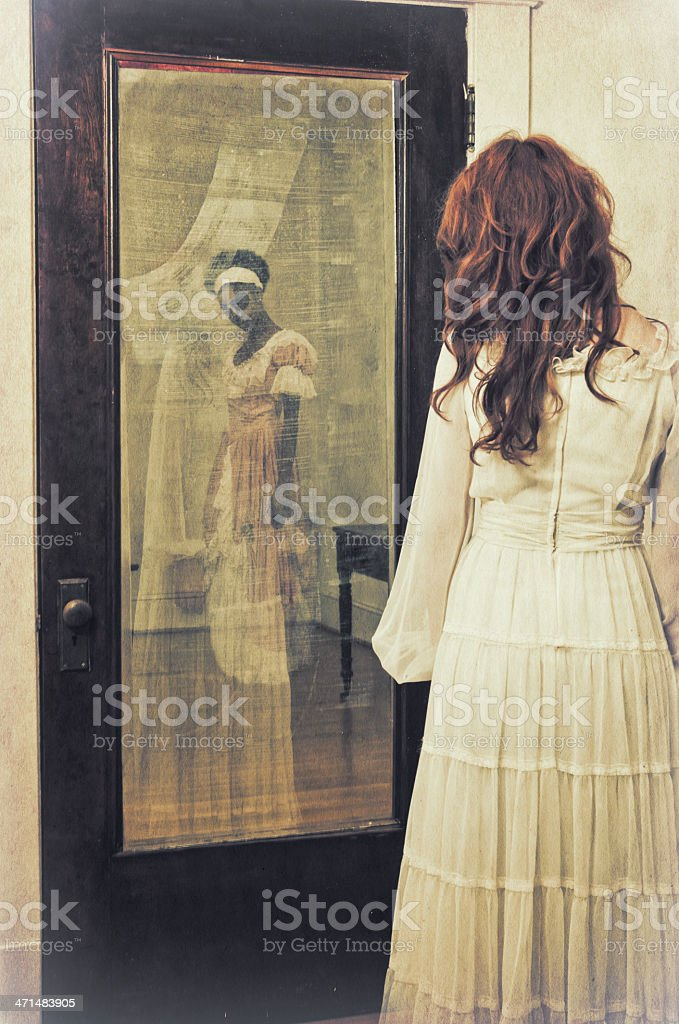 Slave's ghostly reflection in the mirror - II stock photo