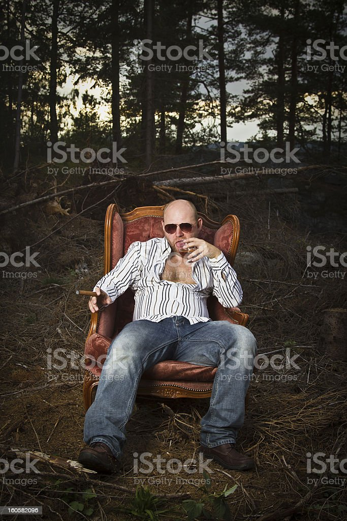 Sleazy Man in a Vintage Chair royalty-free stock photo