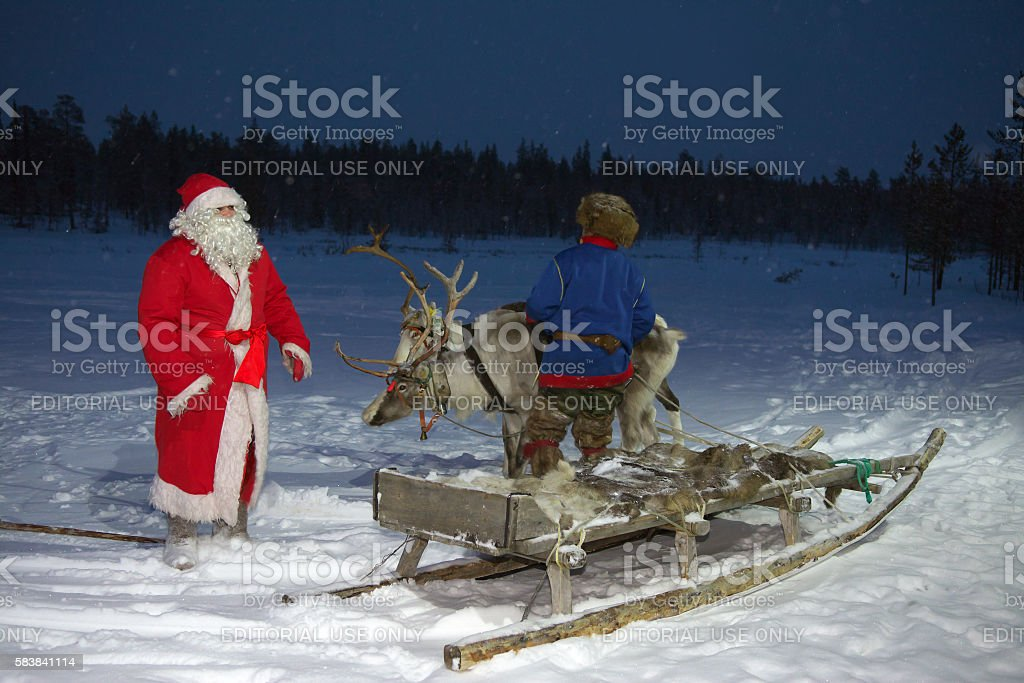 Sled with reindeer team meets Santa Claus stock photo