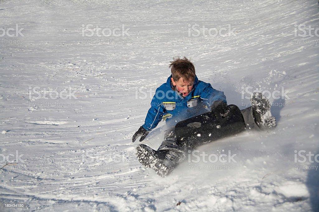 sledding boy royalty-free stock photo