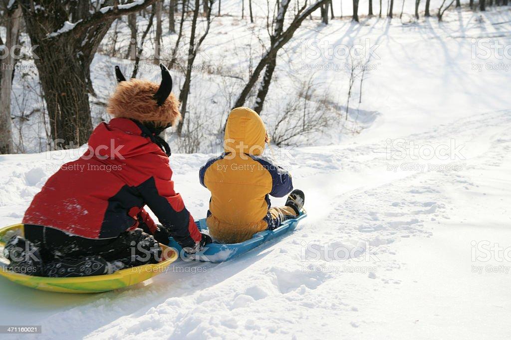 Sledding Brothers Series stock photo
