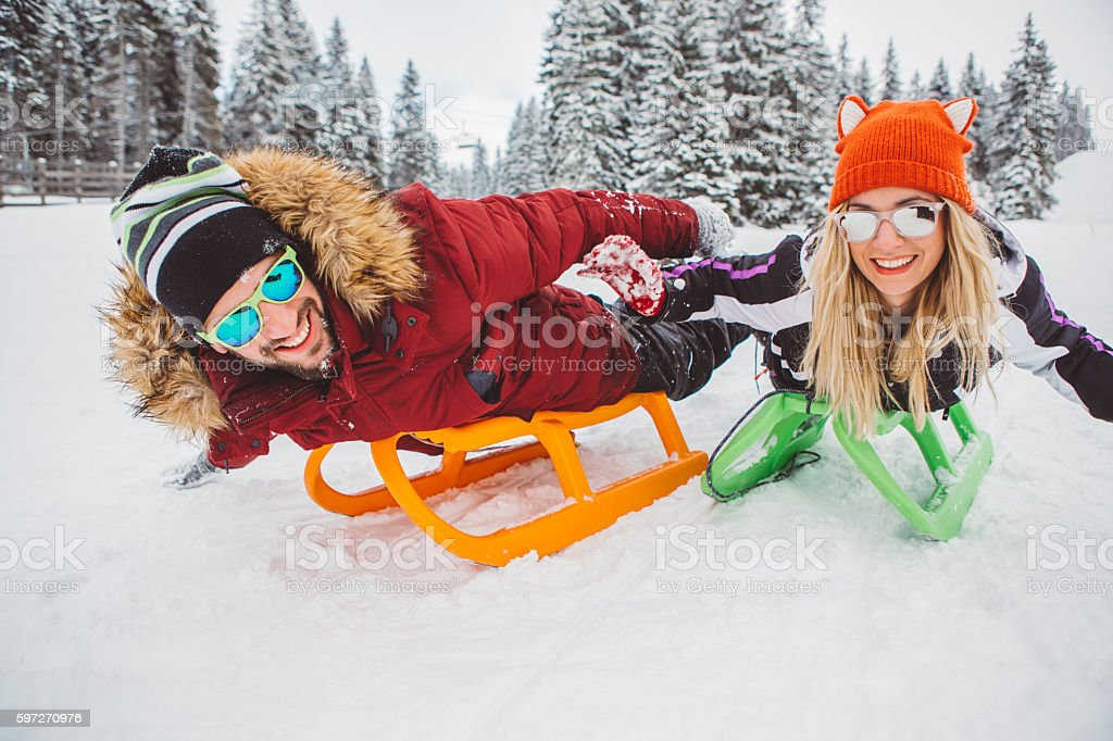 Sledding down a mountain stock photo