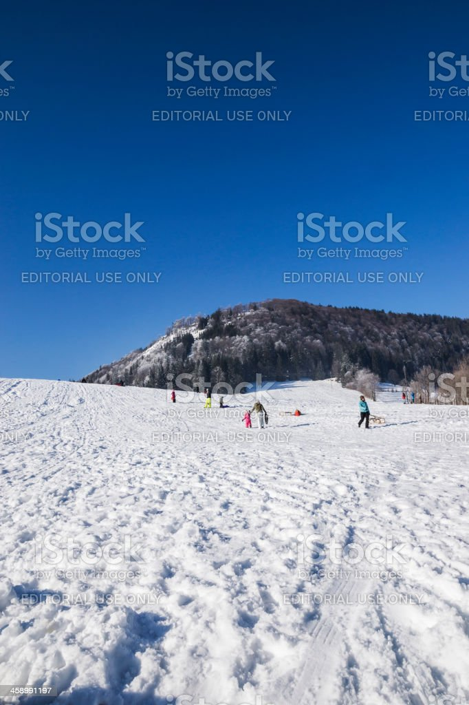 Sledding Outdoors in Winter stock photo