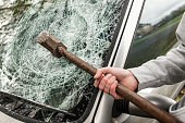 Sledge Hammer in a car windscreen.