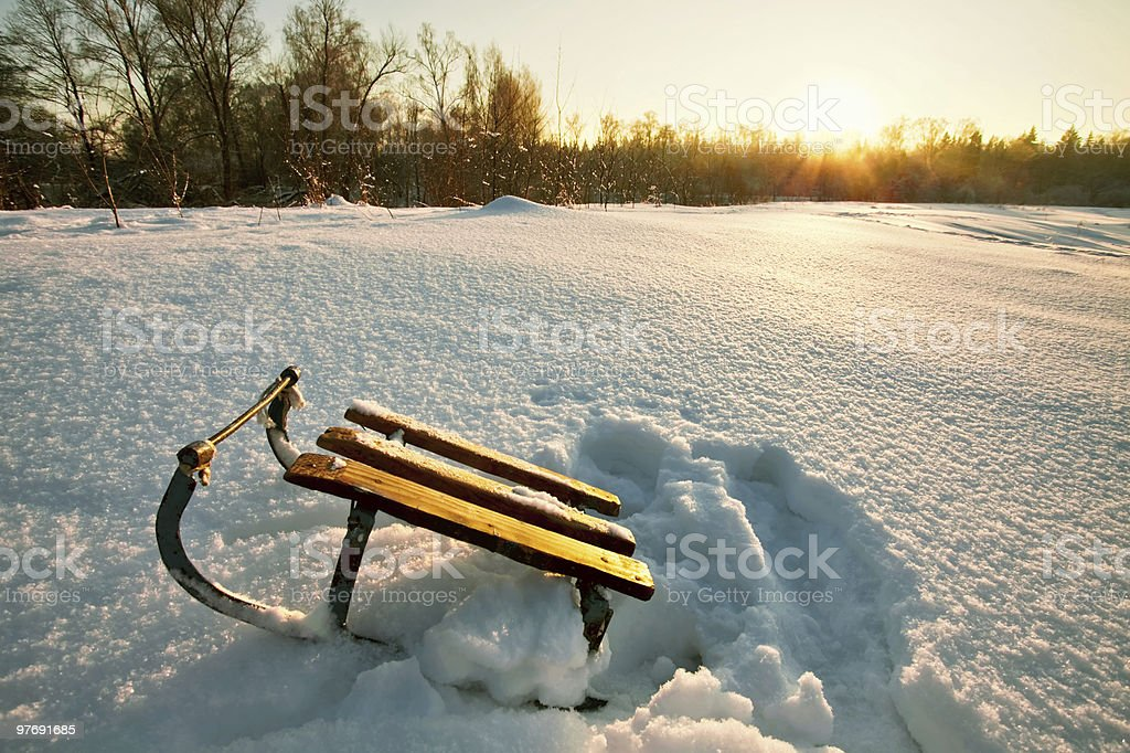 Sledge in a winter field royalty-free stock photo