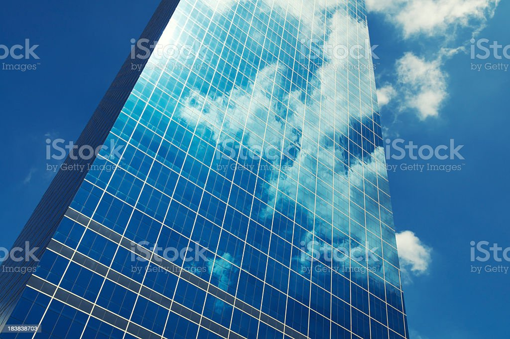 Sleek Glass Office Skyscraper Blue Sky Business Reflection stock photo