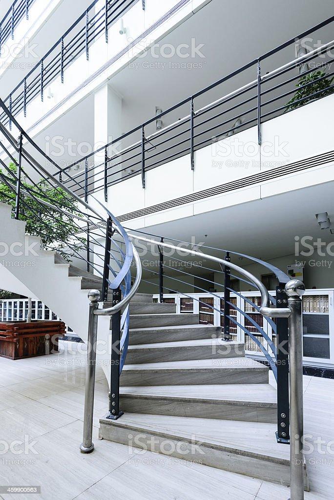 Sleek metal spiral staircase, modern architectural interior decoration. royalty-free stock photo