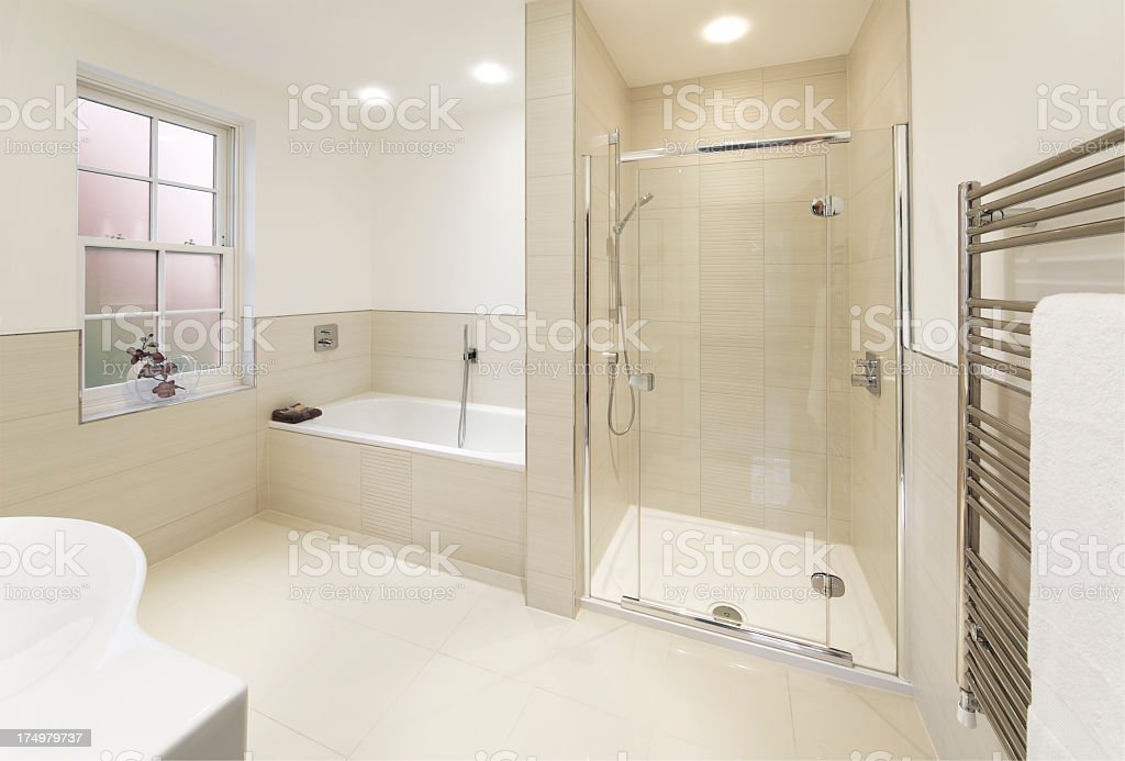 Sleek, modern, off-white tiled bathroom stock photo