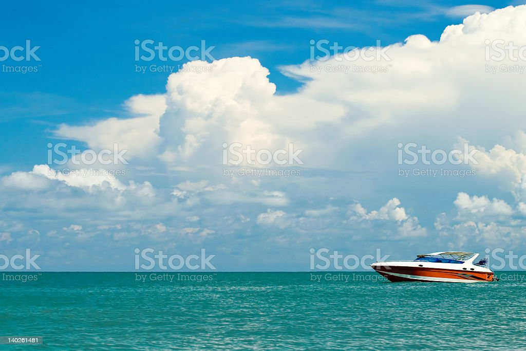 A sleek motorboat on a calm, blue ocean stock photo