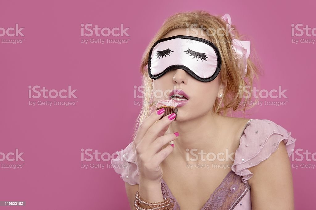 sleep mask blind blonde with sweet temptation pastry stock photo