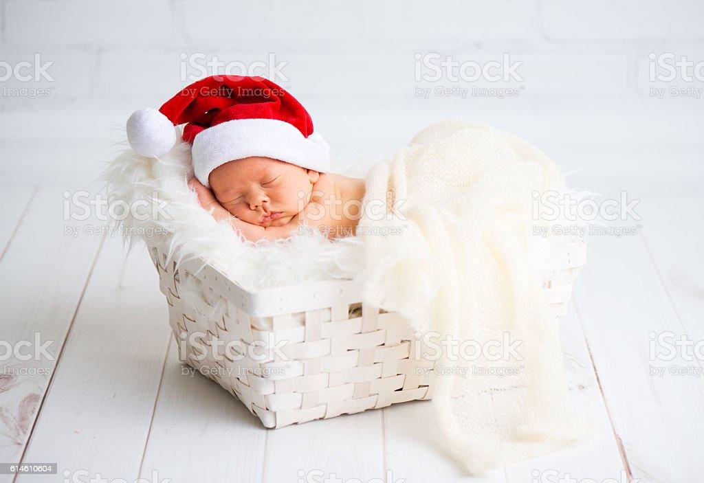 sleeper newborn baby in  Christmas Santa cap stock photo