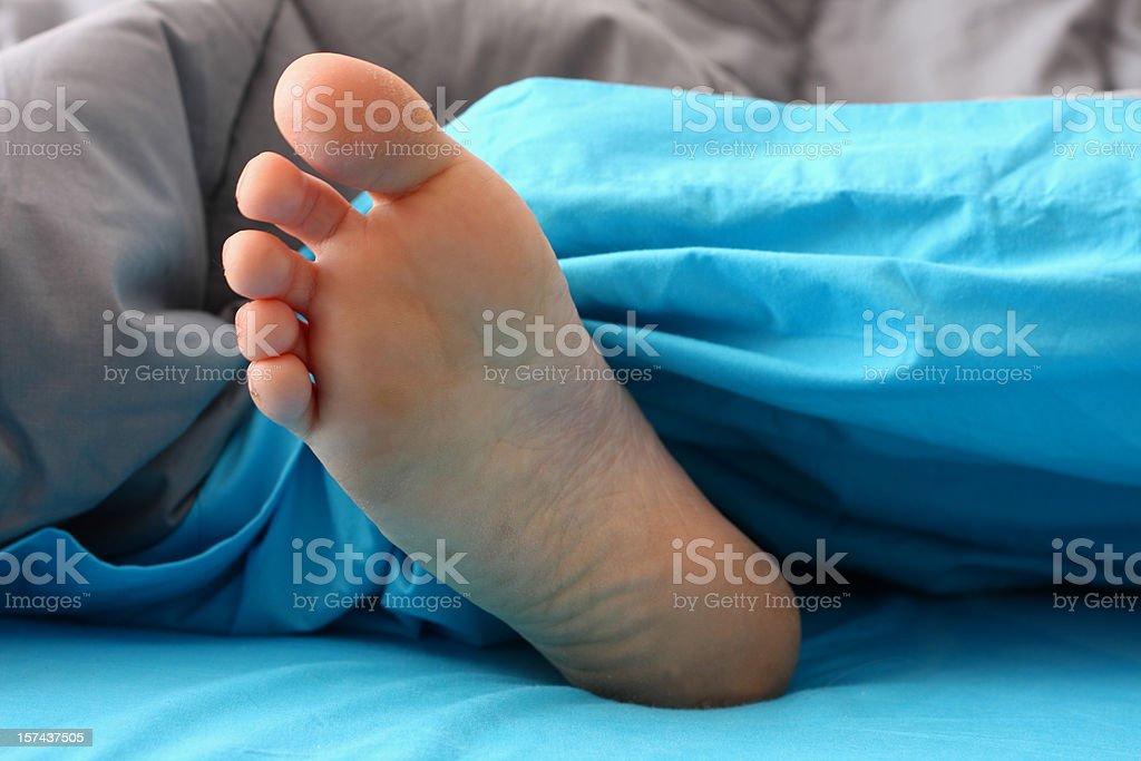 Sleeper's foot royalty-free stock photo